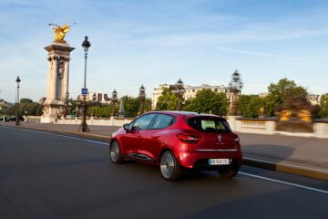 2012 Red Renault Clio driving in Paris
