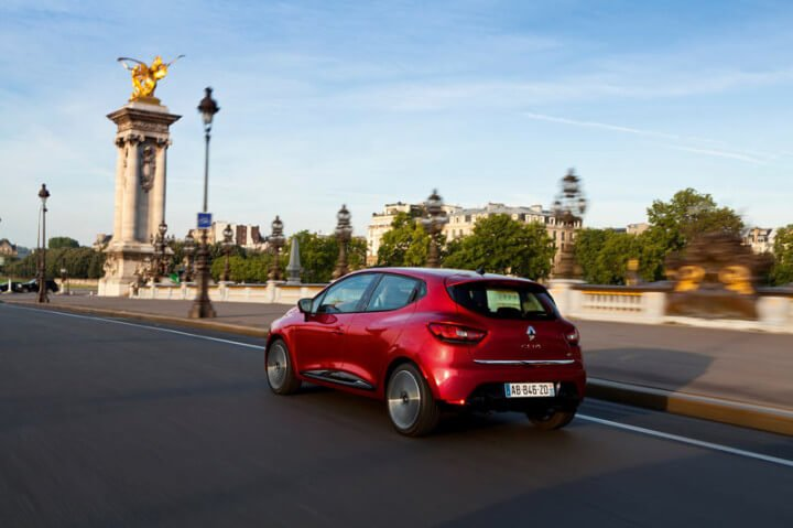 2012 Red Renault Clio driving in Paris