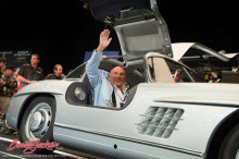 Sterlling Moss driving a Mercedes Benz 300 SL Gullwing at Barrett Jackson Scottsdale 2014 sale