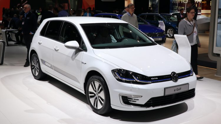 White Volkswagen e Golf. First Semester 2020: Volkswagen, Renault, and Tesla were the best-selling electric car brands in Germany with the VW Golf, Zoe, and Model 3 the top-selling car models.
