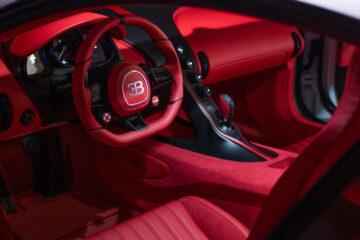 "Bugatti Chiron Super Sport Interior The Pur Sport color split contrasts with the ""Italian Red"" leather interior."