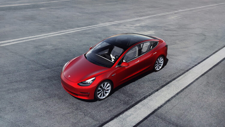 Tesla Model 3 red In full-year 2020, Tesla sales, production, and global deliveries of new cars worldwide were around half a million electric vehicles.